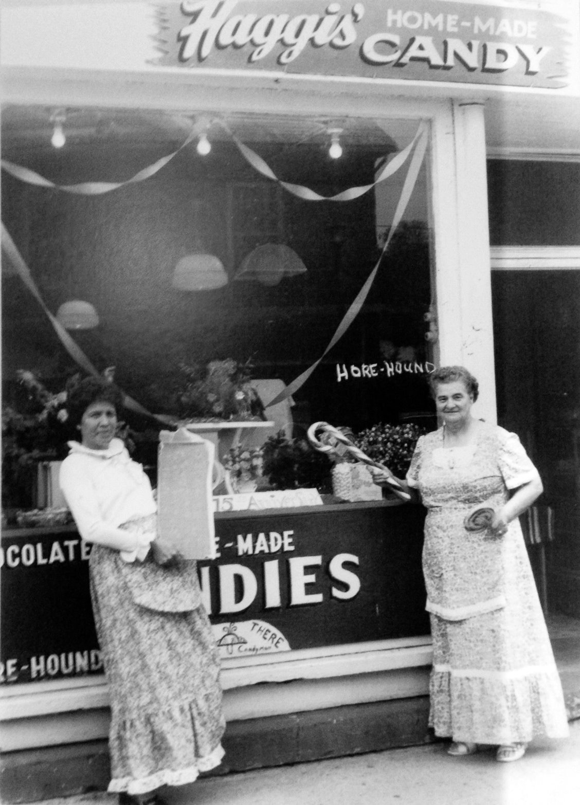 Picture: Sophia (right) in front of her famous candy shop
